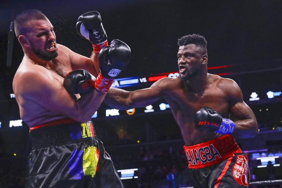 Nigeria's Efe Ajagba punches Romania's Razvan Cojanu during the third round of a heavyweight boxing match Saturday, March 7, 2020, in New York. Ajagba stopped Cojanu in the ninth round. (AP Photo/Frank Franklin II)