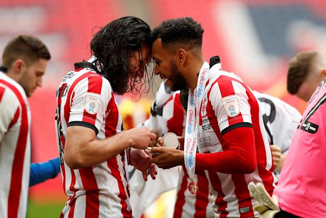 "Soccer Football - Checkatrade Trophy Final - Lincoln City vs Shrewsbury Town - Wembley Stadium, London, Britain - April 8, 2018 Lincoln City's Michael Bostwick (L) and Matt Green celebrate after winning the Checkatrade Trophy Action Images/Andrew Boyers EDITORIAL USE ONLY. No use with unauthorized audio, video, data, fixture lists, club/league logos or ""live"" services. Online in-match use limited to 75 images, no video emulation. No use in betting, games or single club/league/player publications. Please contact your account representative for further details."
