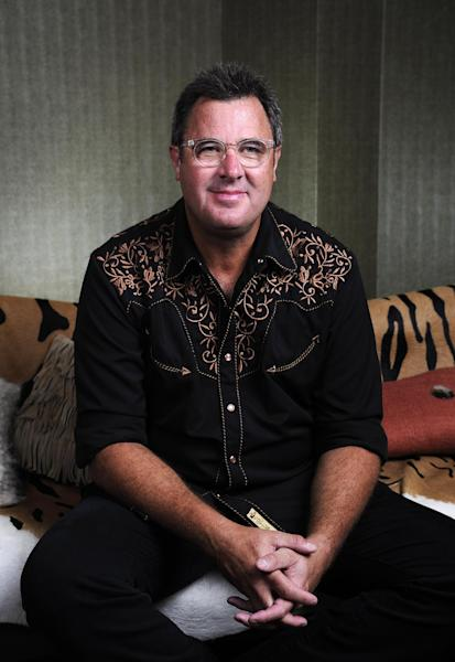"""This Saturday, July 27, 2013 photo shows Vince Gill posing at the Grand Ole Opry in Nashville, Tenn. Gill and Franklin released their latest album """"Bakersfield,"""" on July 30. (Photo by Donn Jones/Invision/AP)"""