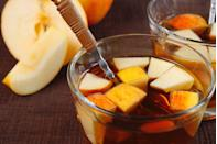"""<p>Reward yourself after a hard day apple-picking and hay riding with this boozy punch. Use a vintage bowl to show off its pretty color. </p><p><strong>Ingredients:</strong></p><p>1 1⁄2 cups fresh lemon juice<br>2 cups strong chai tea, brewed<br>2 cups apple cider<br>1 1⁄2 cups maple syrup<br>4 dashes orange bitters<br>3 cups <a href=""""https://drizly.com/liquor/whiskey/bourbon/makers-mark-bourbon-whisky/p1254?variant=1736"""" rel=""""nofollow noopener"""" target=""""_blank"""" data-ylk=""""slk:Maker's Mark® Bourbon"""" class=""""link rapid-noclick-resp"""">Maker's Mark® Bourbon<br></a>2 cups dry hard cider<br>4 cups sparkling water<br>Apple slices, lemon slices, and cinnamon sticks for garnish</p><p><strong>Directions:</strong></p><p>Combine lemon juice, maple syrup, chai tea, apple and hard apple ciders, bitters, and bourbon in a large punch bowl. Immediately before serving, add a few generous scoops of ice and top with sparkling water.</p>"""
