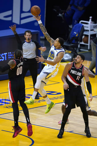 Golden State Warriors forward Juan Toscano-Anderson (95) drives to the basket against Portland Trail Blazers' Carmelo Anthony (00) and Enes Kanter (11) during the first half of an NBA basketball game in San Francisco, Friday, Jan. 1, 2021. (AP Photo/Tony Avelar)