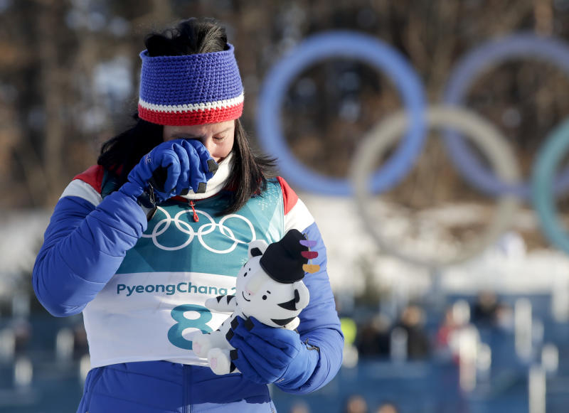 Marit Bjoergen, of Norway, wipes a tear away after winning the gold medal in the women's 30k cross-country skiing competition at the 2018 Winter Olympics in Pyeongchang, South Korea, Sunday, Feb. 25, 2018. (AP Photo/Dmitri Lovetsky)