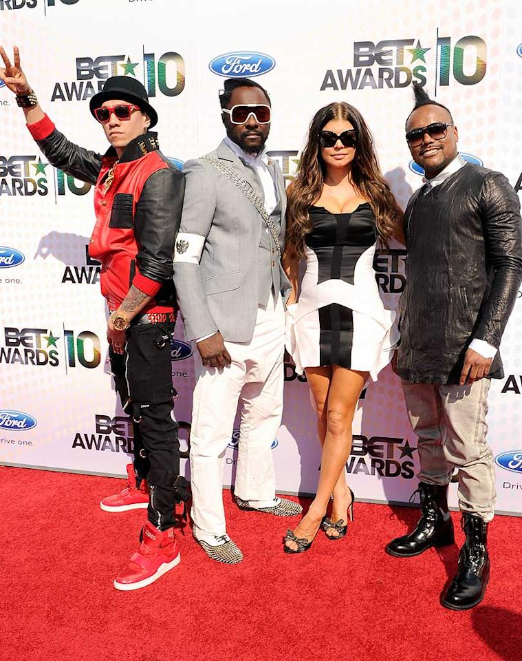 "While they didn't perform ""Boom Boom Pow,"" the Black Eyed Peas arrived ready to rock as usual in their giant sunglasses and funky footwear. Kevin Mazur/<a href=""http://www.wireimage.com"" target=""new"">WireImage.com</a> - June 27, 2010"