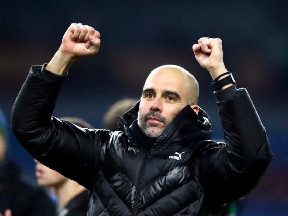 Pep Guardiola celebrates a key win at Burnley (PA)
