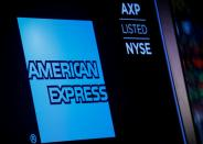 American Express logo and trading symbol are displayed on a screen at the NYSE in New York