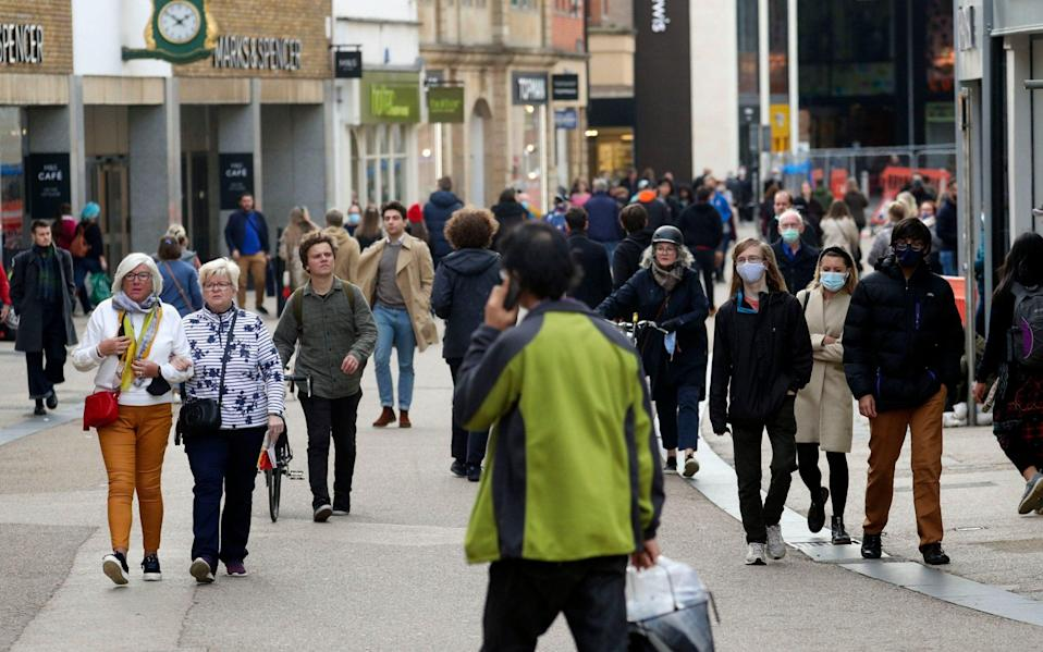 Shoppers in Oxford, which will come under Tier 2 on Saturday  - Steve Parsons/PA