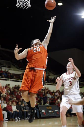 Pacific's Brianna Johnson (20) grabs a rebound next to Stanford's Mikaela Ruef (3) during the first half of an NCAA women's college basketball game in Stanford, Calif., Saturday, Dec. 15, 2012. (AP Photo/Marcio Jose Sanchez)