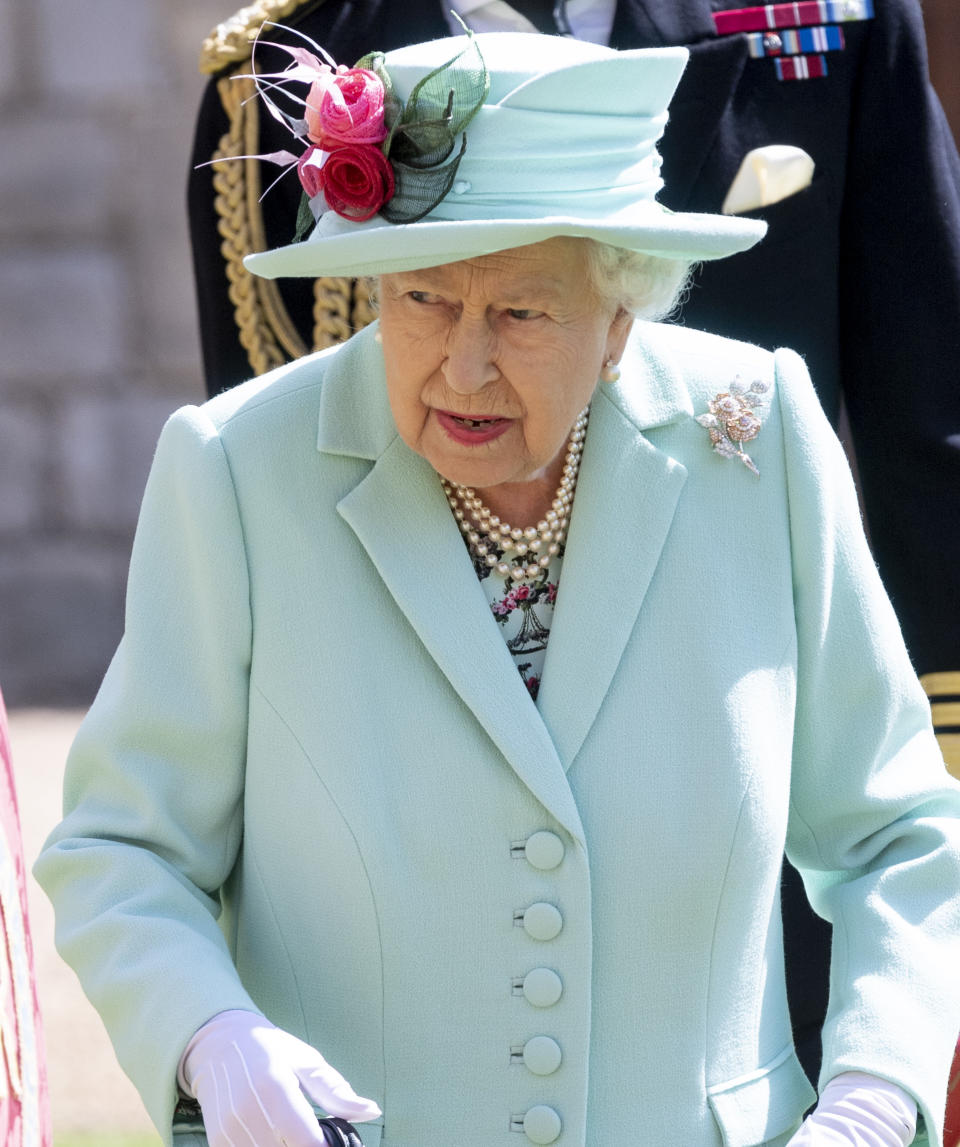 WINDSOR, ENGLAND - JULY 17: Queen Elizabeth II arrives to award Captain Sir Thomas Moore with the insignia of Knight Bachelor at Windsor Castle on July 17, 2020 in Windsor, England. British World War II veteran Captain Tom Moore raised over £32 million for the NHS during the coronavirus pandemic. (Photo by UK Press Pool/UK Press via Getty Images)