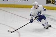 FILE - In this April 1, 2019, file photo, Toronto Maple Leafs' Nikita Zaitsev skates with the puck during the third period of an NHL hockey game against the New York Islanders, in Uniondale, N.Y. The Toronto Maple Leafs acquired defenseman Cody Ceci, a 2020 third-round pick and minor leaguers Ben Harpur and Aaron Luchuk from the Ottawa Senators for defenseman Nikita Zaitsev, forward Connor Brown and minor leaguer Michael Carcone. The teams announced the trade early on Monday, July 1, 2019, roughly three and a half hours before the start of free agency. (AP Photo/Frank Franklin II, File)