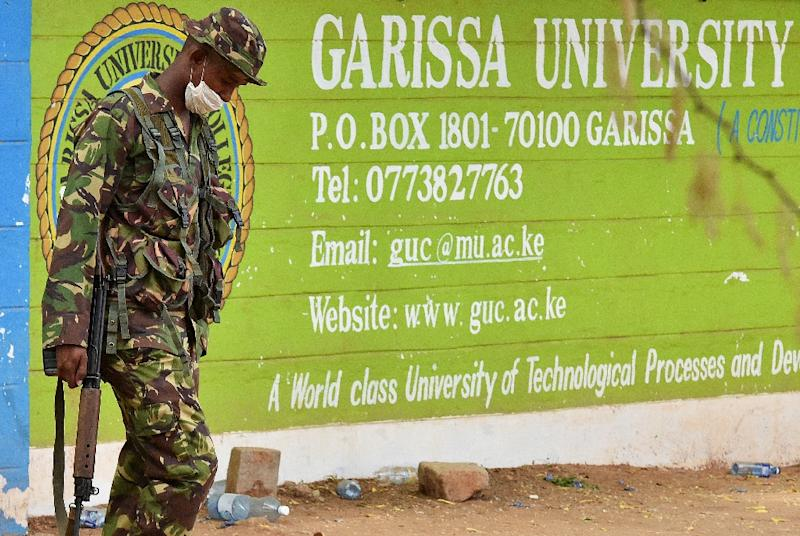 A Kenya Defence forces soldier walks past the front entrance of Moi University Garissa on April 3, 2015 after a massacre of students by Somalia's Al-Qaeda-linked Shebab fighters (AFP Photo/Carl de Souza)