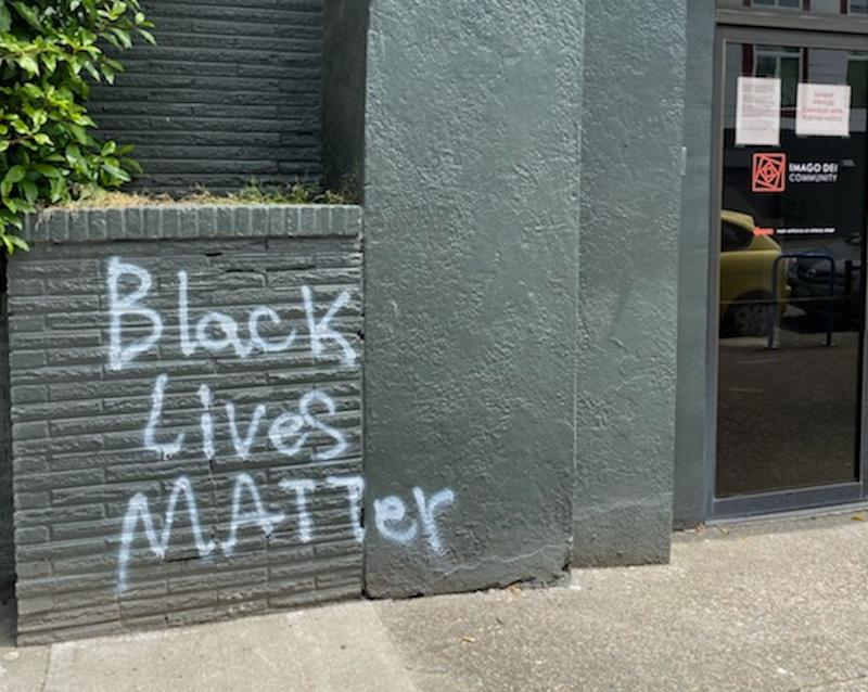 "The tagging happened in June, early on in the protests. As Portland has become a hotbed of clashes between federal forces and protesters, associate pastor Michelle Jones said the mural ""reminds those who see it that with so many things happening at the same time, justice matters."" (Photo: Courtesy of Michelle Jones)"