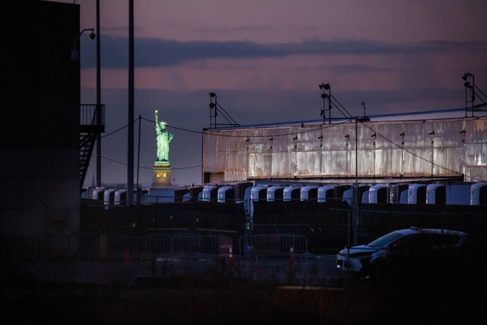 A COVID-19 disaster morgue made up of refrigerated trailers stands at the South Brooklyn Marine Terminal during the COVID-19 pandemic in the Brooklyn borough of New York, United States, Dec. 14, 2020. (Photo by Michael Nagle/Xinhua via Getty)