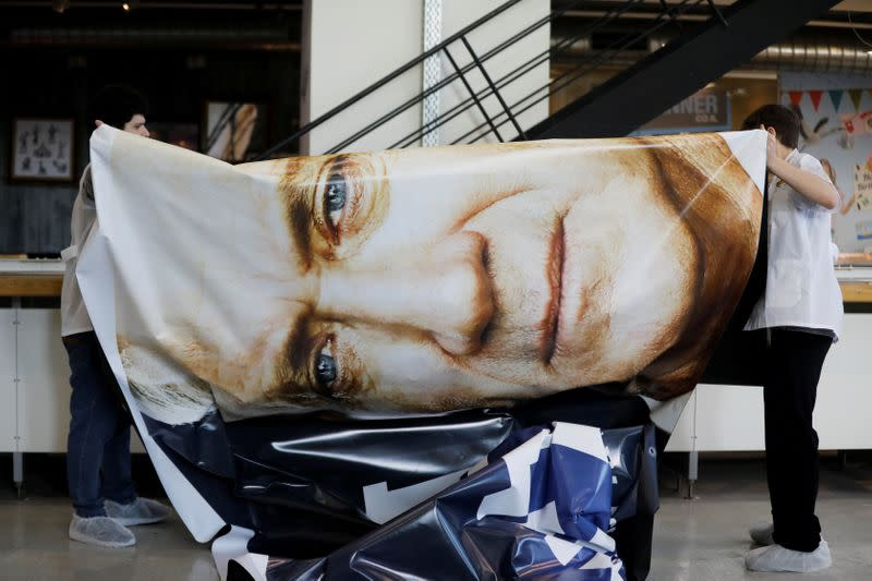 FILE PHOTO: Workers prepare a  billboard for the election campaign  of Blue and White Party in a printing house in Tel Aviv