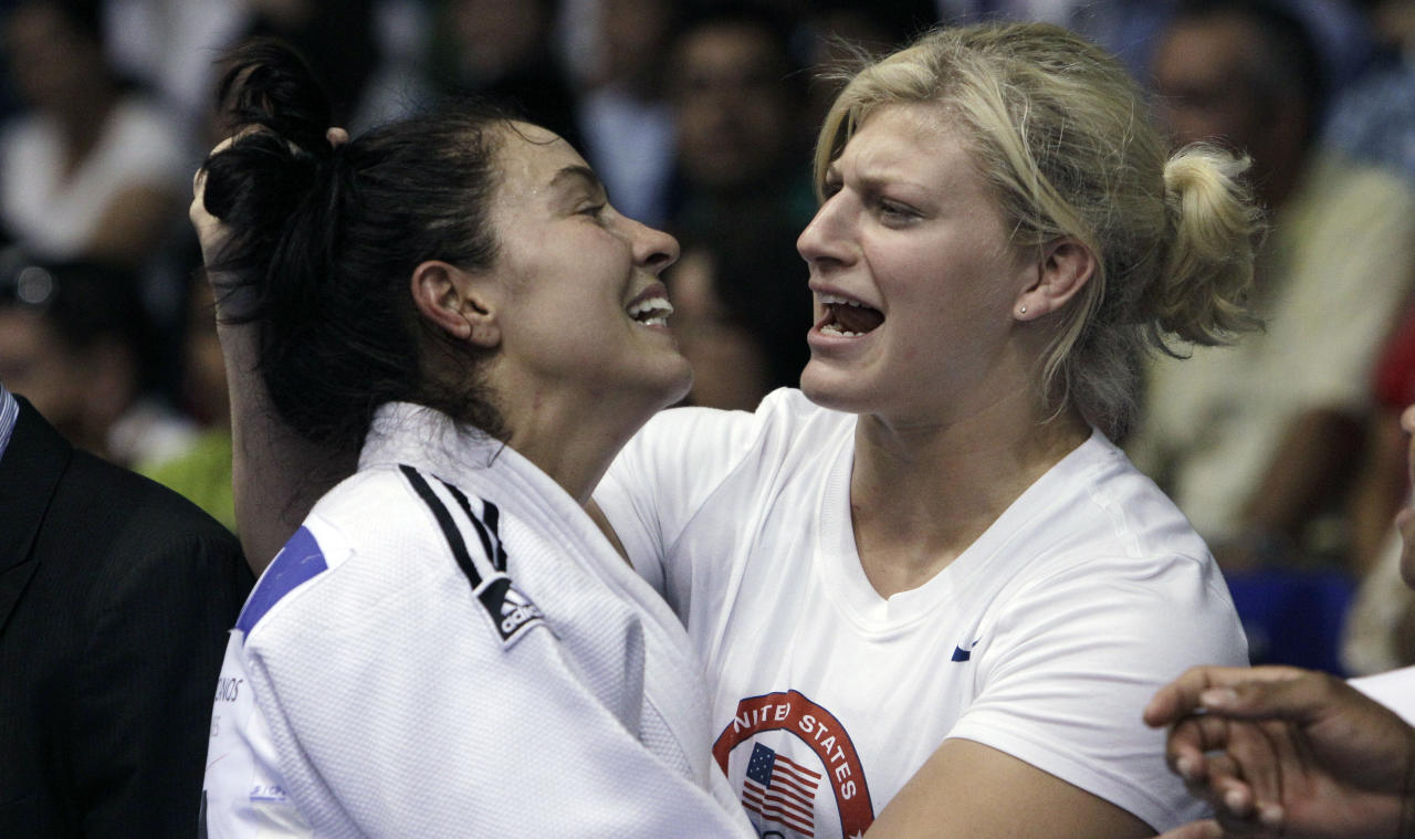 Kayla Harrison congratulates teammate Christal Ransom, left, both from the United States, after Ransom won the judo women's -63 kg bronze medal at the Pan American Games in Guadalajara, Mexico, Friday, Oct. 28, 2011.(AP Photo/Javier Galeano)