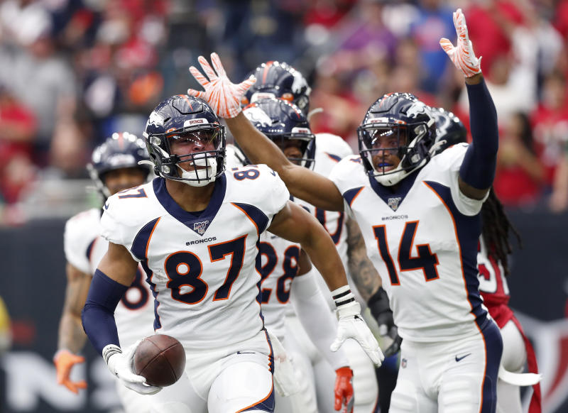 HOUSTON, TEXAS - DECEMBER 08: Noah Fant #87 of the Denver Broncos celebrates his touchdown in the first quarter with teammate Courtland Sutton #14 in the first quarter against the Houston Texans at NRG Stadium on December 08, 2019 in Houston, Texas. (Photo by Tim Warner/Getty Images)
