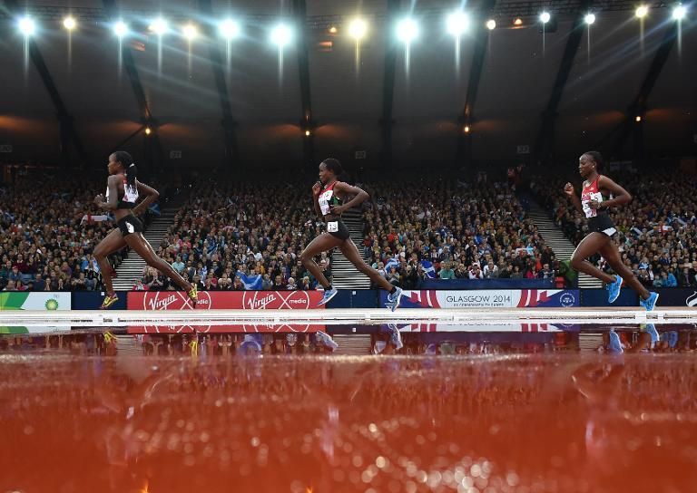 Kenya's Mercy Cherono (L) leads the final of the women's 5000m athletics event at Hampden Park during the 2014 Commonwealth Games in Glasgow, Scotland on August 2, 2014 (AFP Photo/Ben Stansall )