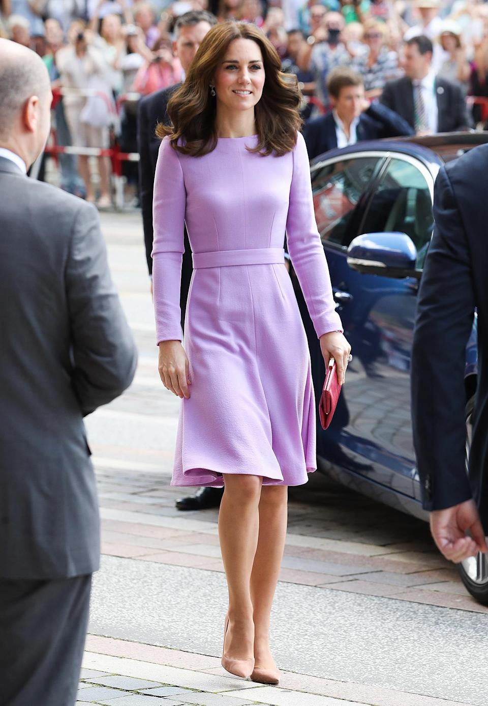 <p><strong>When:</strong> July 21, 2017 <strong>Where:</strong> Berlin Hauptbahnhof main railway station. <strong>Wearing:</strong> Emilia Wickstead lavender dress <strong>Get the Look:</strong> Tom Ford Zip-Trim Scoop-Back Long-Sleeve Dress, $1,990; <span>neimanmarcus.com</span> Tie Sleeve Wrap Dress, $90; <span>topshop.com</span> Jack by BB Dakota Simone Rayon Crepe Lace-Front Dress + Slip; $40; <span>zappos.com</span> Gianni Bini Piper Cold-Shoulder Wrap Dress, $26.70; <span>dillards.com</span></p>