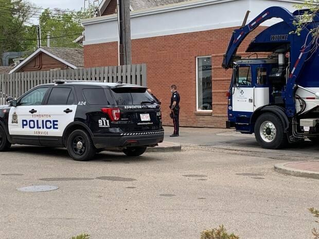 The incident happened around 7 a.m. Wednesday in an alley near 125th Street and 102nd Avenue, police said. (Craig Ryan/CBC - image credit)
