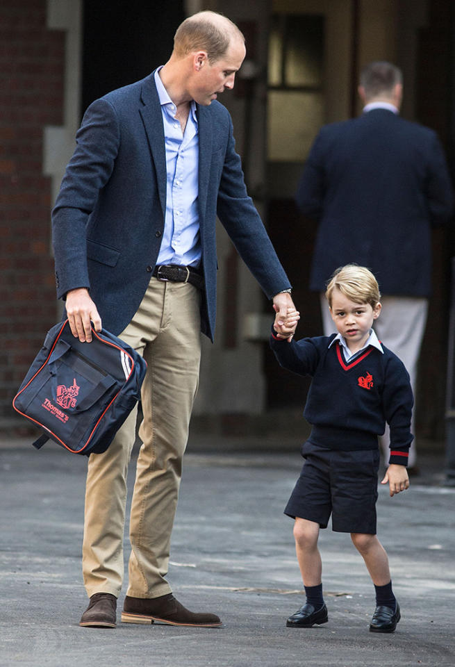<p>The young royal strolled into his first day of school with his dad, Prince William, by his side on Sept. 7. (His mum, Kate Middleton, whose third pregnancy was announced earlier this week, has been home with acute morning sickness.) The 4-year-old, who will be known as George Cambridge by classmates, was greeted by the headmistress as he arrived in his summer school uniform. (Prince William was on backpack duty.) While this is George's first day of real school, he previously attended a Montessori pre-school. (Photo: RICHARD POHLE/AFP/Getty Images) </p>