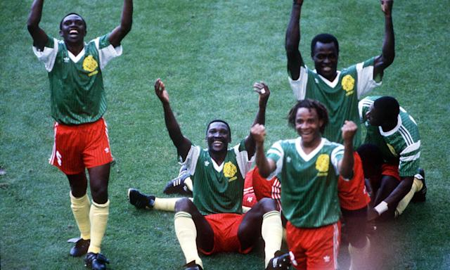 Cameroon players celebrate their goal.
