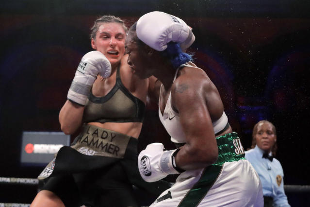 Christina Hammer, left, and Claressa Shields fight during the 10th round of a women's middleweight championship boxing bout, Saturday, April 13, 2019, in Atlantic City, N.J. Shields won by unanimous decision. (AP Photo/Julio Cortez)