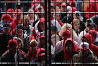 ST LOUIS, MO - OCTOBER 19: Fans stand in the rain as the they wait to enter Busch Stadium prior to Game One of the MLB World Series between the Texas Rangers and St Louis Cardinals on October 19, 2011 in St Louis, Missouri. (Photo by Doug Pensinger/Getty Images)