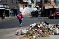 FILE PHOTO: A pile of uncollected garbage is seen on a street as Venezuelan utilities have hiked fees while the economy deteriorates further due to the spread of coronavirus disease (COVID-19) and the crash in global oil prices, in Caracas