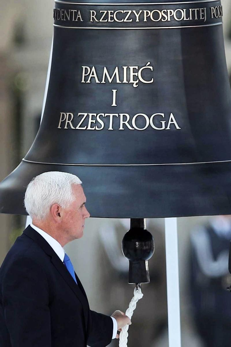 Vice President Mike Pence rings the Bell of Memory and Warning during a ceremony at Pilsudski Square in Warsaw, Poland, on Sept. 1, 2019. The ceremony marked the 80th anniversary of start of World War II.