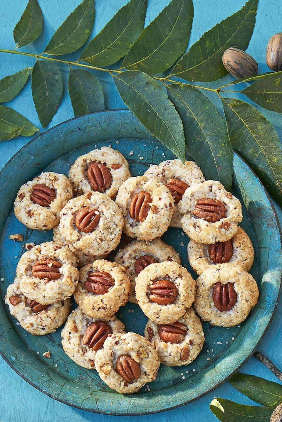 """<p>Add pecans to classic shortbread cookies for a sweet and nutty treat.</p><p><em><a href=""""https://www.countryliving.com/food-drinks/recipes/a45303/pecan-shortbread-cookie-recipe/"""" rel=""""nofollow noopener"""" target=""""_blank"""" data-ylk=""""slk:Get the recipe from Country Living »"""" class=""""link rapid-noclick-resp"""">Get the recipe from Country Living »</a></em></p>"""