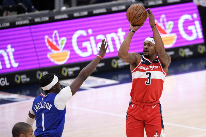 Washington Wizards guard Bradley Beal (3) shoots against Los Angeles Clippers guard Reggie Jackson (1) during the first half of an NBA basketball game, Thursday, March 4, 2021, in Washington. (AP Photo/Nick Wass)
