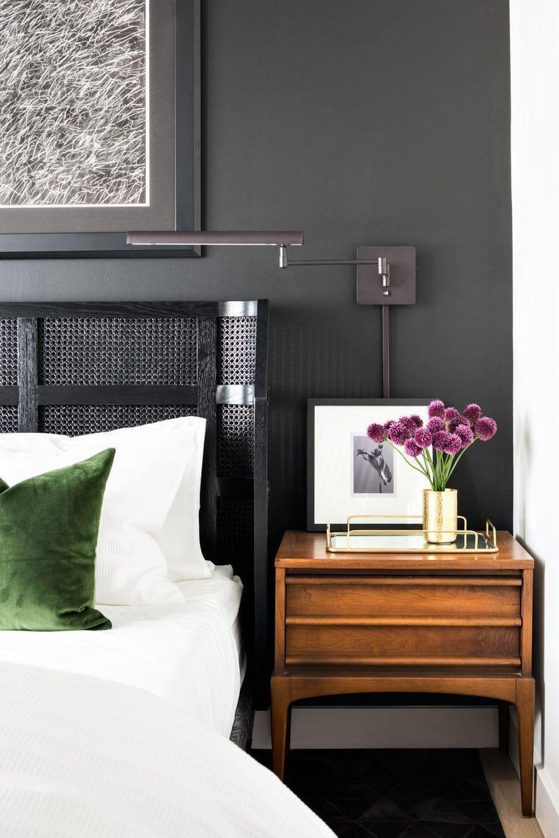 <p>Opting for a deep hue, like gray, is an easy way to give your bedroom a cocoon-like feel. Introduce contrast with white bedding and wood nightstands. </p>