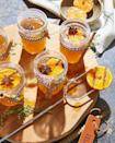 """<p>Charring the oranges over a grill or in your oven's broiler adds a deep caramelized flavor that will make guests go """"wow!"""" </p><p><strong><a href=""""https://www.countryliving.com/food-drinks/a34945104/hot-toddy-with-charred-oranges-recipe/"""" rel=""""nofollow noopener"""" target=""""_blank"""" data-ylk=""""slk:Get the recipe"""" class=""""link rapid-noclick-resp"""">Get the recipe</a>.</strong></p>"""