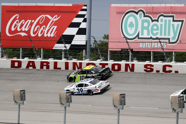 Ross Chastain (10) and Ryan Sieg (39) drive during the NASCAR Xfinity series auto race Thursday, May 21, 2020, in Darlington, S.C. (AP Photo/Brynn Anderson)