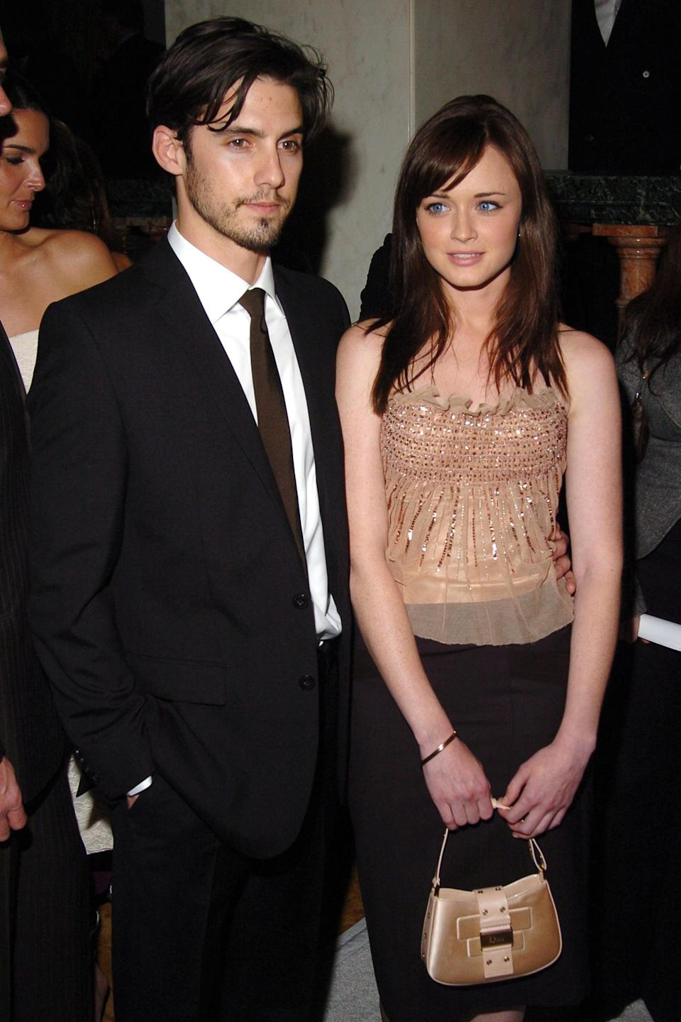 """<p>Hayden wasn't the only costar Milo ever dated. Before <strong>Heroes</strong>, Milo got together with his onscreen love interest Alexis on <strong><a class=""""link rapid-noclick-resp"""" href=""""https://www.popsugar.co.uk/Gilmore-Girls"""" rel=""""nofollow noopener"""" target=""""_blank"""" data-ylk=""""slk:Gilmore Girls"""">Gilmore Girls</a></strong>. The actors dated for over three years until - just like their characters, Jess and Rory - the couple parted ways in 2006. A decade later, they ended up reuniting for the show's 2016 Netflix reboot, <strong>Gilmore Girls: A Year in the Life</strong><em>.</em></p> <p>Though <a href=""""http://www.indiewire.com/2016/11/gilmore-girls-alexis-bledel-netflix-revival-rory-boyfriends-1201747401/"""" class=""""link rapid-noclick-resp"""" rel=""""nofollow noopener"""" target=""""_blank"""" data-ylk=""""slk:Alexis didn't explicitly comment on her experience"""">Alexis didn't explicitly comment on her experience</a> working with Milo 10 years after their breakup, she did say during the Television Critics Association press tour in July 2016 that """"it was great to work with all of them again,"""" referring to all of Rory's past lovers who appeared in the revival. </p> <p>It doesn't seem Milo has any hard feelings, either. Following Alexis' win at the 2017 Primetime Emmy Awards for outstanding guest actress in a drama series for her performance in <strong><a class=""""link rapid-noclick-resp"""" href=""""https://www.popsugar.co.uk/The-Handmaid%E2%80%99s-Tale"""" rel=""""nofollow noopener"""" target=""""_blank"""" data-ylk=""""slk:The Handmaid's Tale"""">The Handmaid's Tale</a></strong>, Milo told <strong>The Daily Dish</strong> that <a href=""""http://www.bravotv.com/the-daily-dish/is-milo-ventimiglia-jealous-of-alexis-bledels-emmy-win"""" class=""""link rapid-noclick-resp"""" rel=""""nofollow noopener"""" target=""""_blank"""" data-ylk=""""slk:he was very happy for her"""">he was very happy for her</a>. """"She's always been a great actor,"""" he added. <br></p>"""