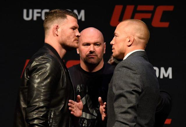 Middleweight champion Michael Bisping (L) squared off with Georges St-Pierre at a March 3 news conference, but the two won't be fighting any time soon. (Getty Images)