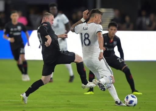 Wayne Rooney (L) of DC United said he likes how football is growing in America and says it might one day rival such leagues as the NFL and NBA