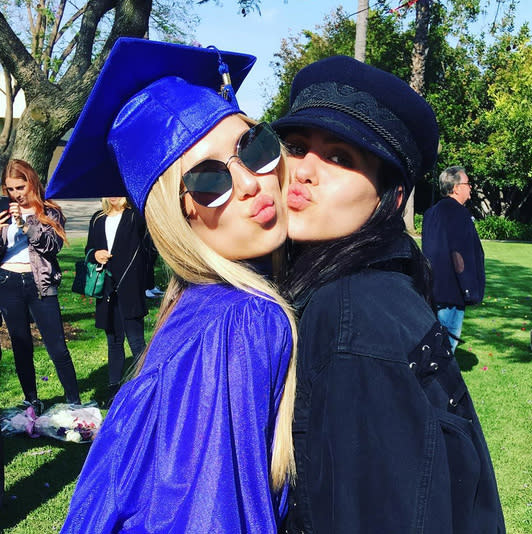 """<p>School's out for the summer — and forever! — for Lisa Rinna and Harry Hamlin's elder daughter, Delilah Belle. The blonde, 18, posed for her mama at her June 8 commencement, doing some fishy kisses with younger sib Amelia Gray. """"Yes she did!!!"""" wrote reality star Rinna. """"Congratulations @delilahbelle. We are so very proud of you!!!!#graduation #nextchapter."""" As for that next chapter, it will involve modeling. Like Sistine Stallone and Presley Gerber, she graduates with a modeling contract. (Photo: Lisa Rinna via Instagram) </p>"""