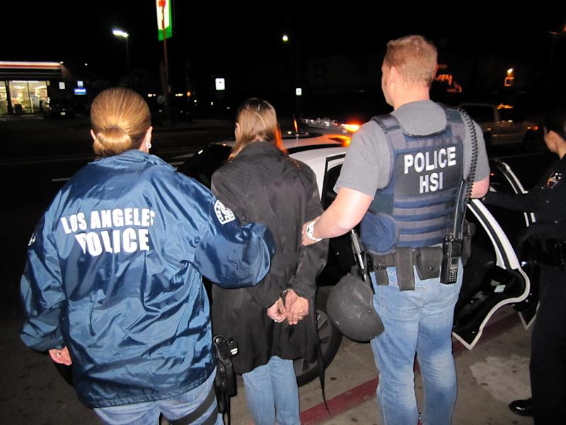 In this image provided by U.S. Immigration and Customs Enforcement (ICE), Letha Mae Montemayor, is arrested on suspicion of child pornography charges, Thursday, Jan. 3, 2013 in Los Angeles. Montemayor, 52, and an unidentified man were arrested a day after ICE officials announced they were looking for a man and woman who appeared to be molesting a 13-year-old girl in widely circulated porn photos. (AP Photo/ICE)