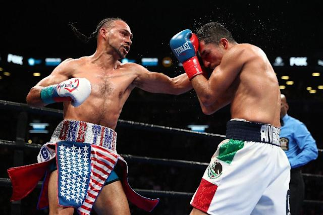 Keith Thurman punches Josesito Lopez on the way to a majority decision victory in their WBA welterweight world title fight (AFP Photo/AL BELLO)