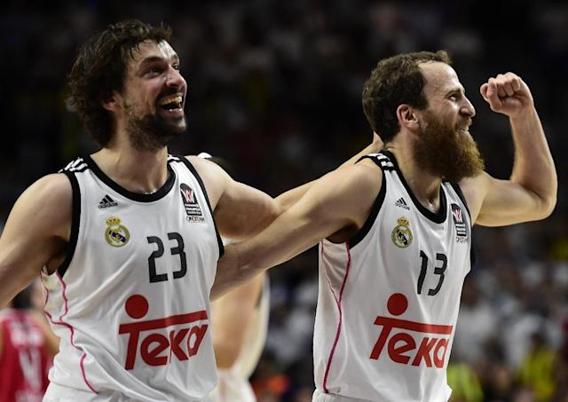Real Madrid's guard Sergio Llull (L) and Real Madrid's guard Sergio Rodriguez celebrate after winning the Euroleague Final Four basketball match final in Madrid on May 17, 2015 (AFP Photo/Javier Soriano)