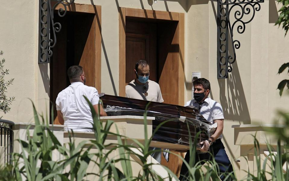 A coffin is taken out of the house where Caroline Crouch was murdered in Glyka Nera in the outskirts of Athens - John Liakos/Intime News/Athena Pictures/Athena Picture Agency Ltd