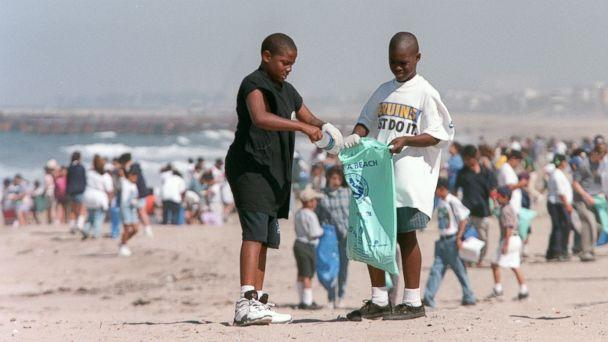 PHOTO: In this file photo, Terrell McNeal, ll, and Tareall Atkins, 10, from Westminister Elementary School in Venice, Calif., clean up plastic bottles on the beach at Dockweiler State beach, April 22, 1997. (Bob Chamberlin/Los Angeles Times via Getty Images, FILE)