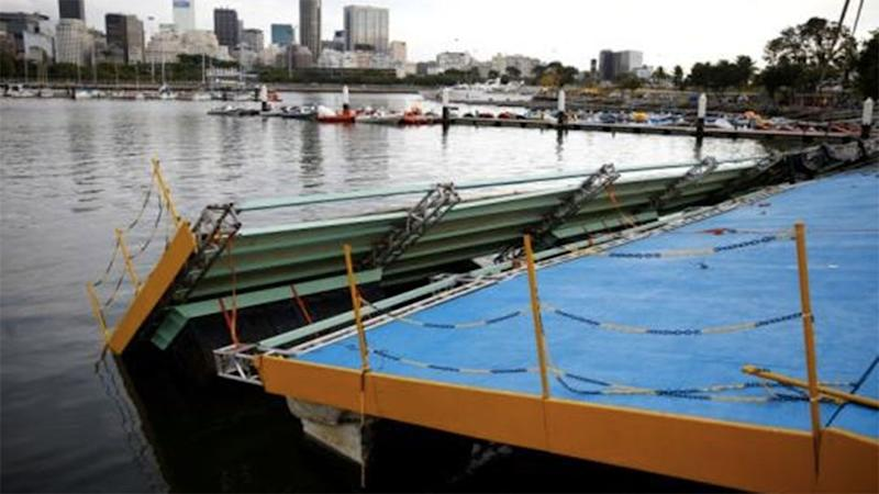 A ramp built for competitors' boats to reach the water hangs after collapsing at the Marina da Gloria sailing venue just days. Photo: Pilar Olivares / Reuters