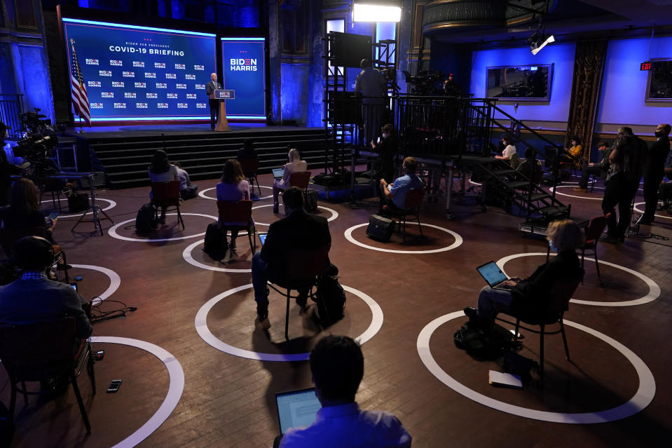FILE - In this Sept. 1, 2020, file photo journalists sit in socially-distant circles as Democratic presidential candidate former Vice President Joe Biden speaks after participating in a coronavirus vaccine briefing with public health experts in Wilmington, Del. (AP Photo/Patrick Semansky, File)