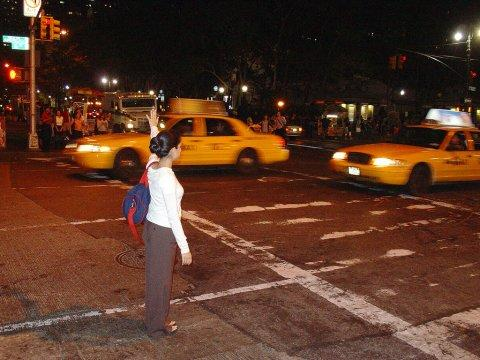 woman hailing a cab in nyc new york