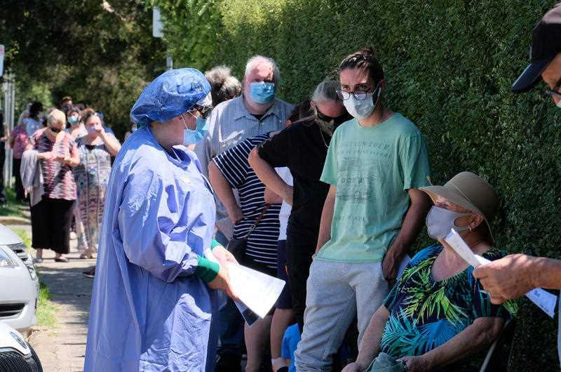 People line up as they wait to be tested for Covid19 at the Sunbury Respiratory Clinic in Melbourne.