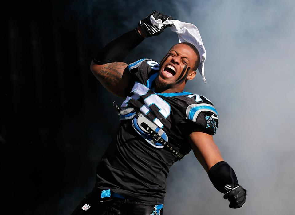Greg Hardy runs onto the field during player introductions ahead of a game on January 12, 2014 in Charlotte, North Carolina (AFP Photo/Kevin C. Cox)