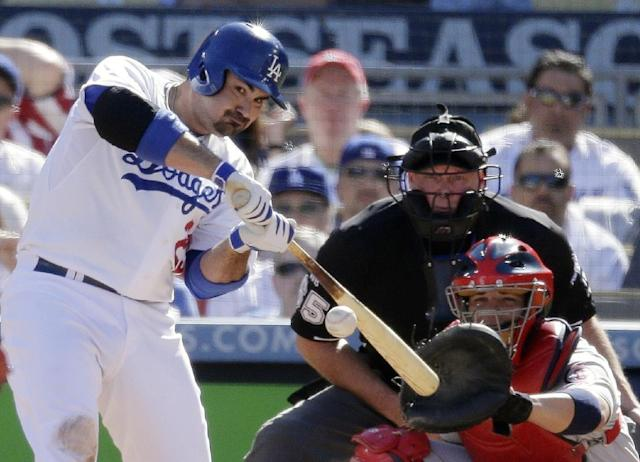 Los Angeles Dodgers' Adrian Gonzalez hits a home run during the third inning of Game 5 of the National League baseball championship series against the St. Louis Cardinals Wednesday, Oct. 16, 2013, in Los Angeles. (AP Photo/Chris Carlson)