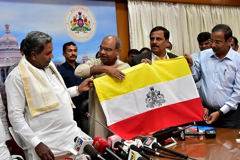 Karnataka government unveils the state flag, awaits Centre's approval