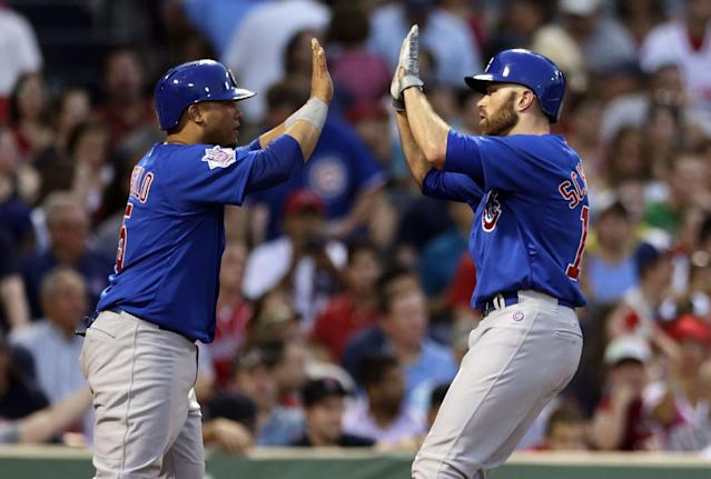 Chicago Cubs' Nate Schierholtz, right, is congratulated by teammate Wellington Castillo after his two-run, home run off Boston Red Sox starting pitcher Jake Peavy during the fourth inning of a baseball game at Fenway Park in Boston, Monday, June 30, 2014. (AP Photo/Charles Krupa)